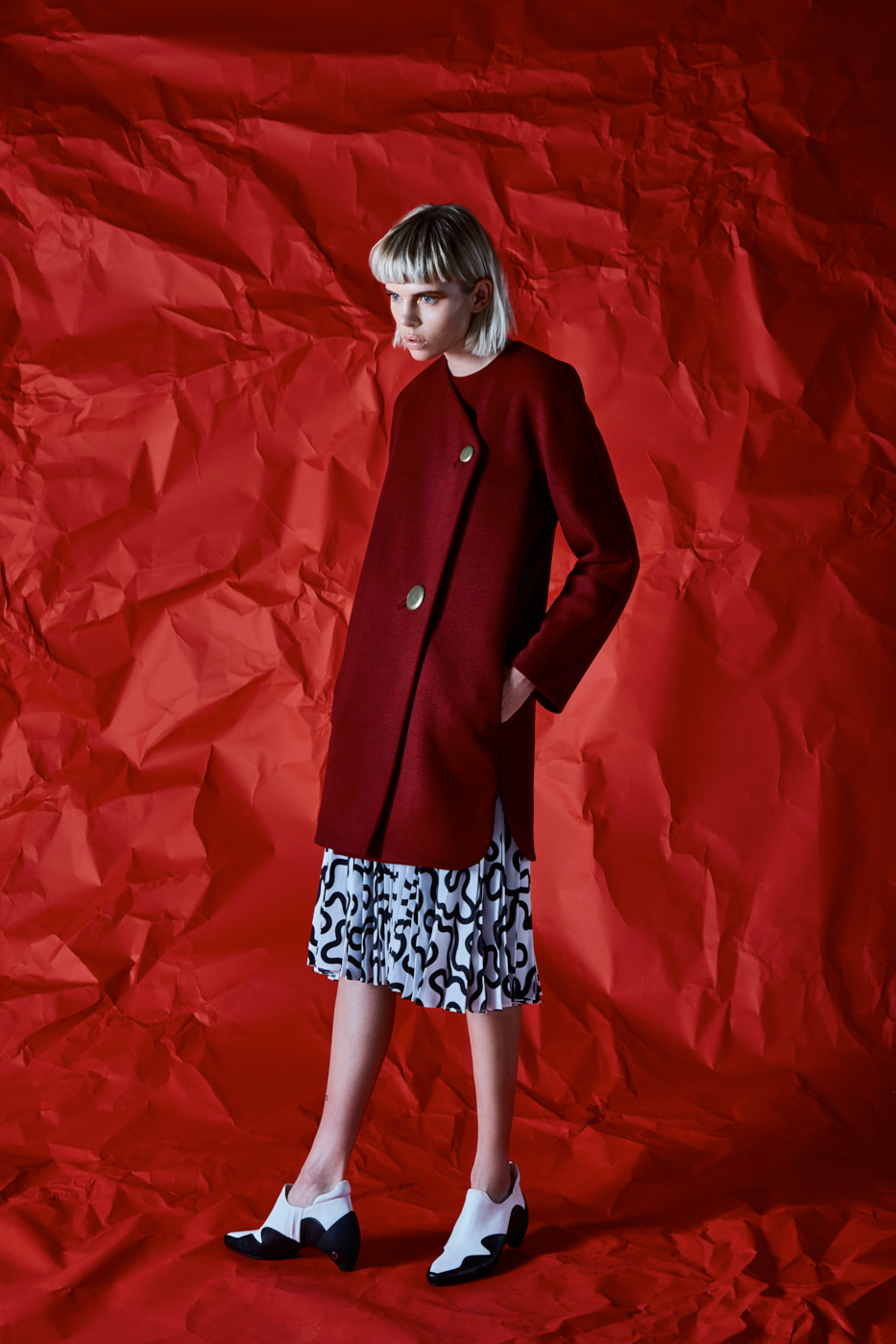 Coat by Balenciaga; skirt by JW Anderson; shoes by Courrèges